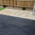Composite deck area, artificial turf & honed sandstone.
