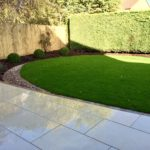 Honed sandstone, dressed edge & turf.