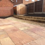 Sandstone paving, decorative aggregate, large bedding areas, sweeping curves 2.