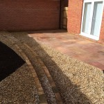 Sandstone paving, decorative aggregate, large bedding areas, sweeping curves 4.