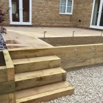 Retaining wall / steps, honed sandstone & lighting.