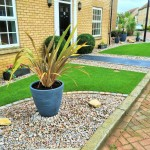 Black limestone, feature plants / Scottish pebbles & turf.