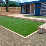Cedar decked area / garden pod & natural turf.