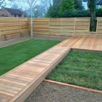 Ceder deck, Larch bespoke fence, natural turf & wild flower turf areas.